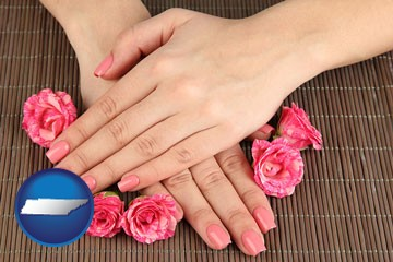 a manicure (pink fingernails) - with Tennessee icon